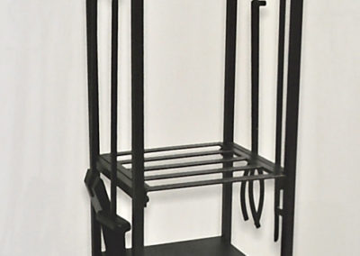 Photo of Black Wrought Iron Log Rack With Tools